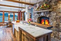 Fireplace in the kitchen of a lakeside Idaho timber frame home