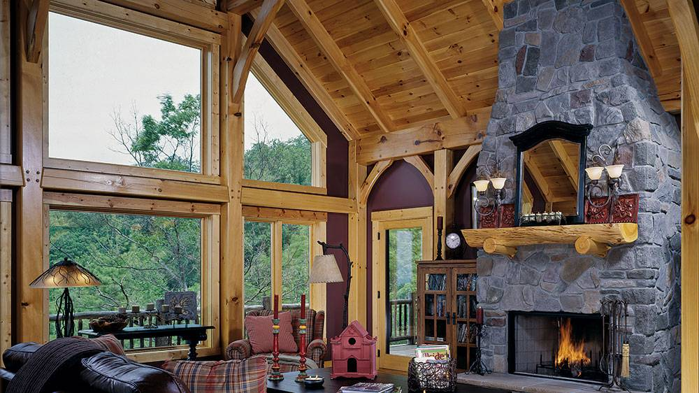 timber frame home fireplace living room mountains